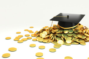 college graduate hat over gold coin